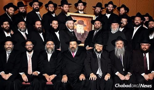 A group shot of Valley shluchim. Gordon is front and center, seated in the first row.