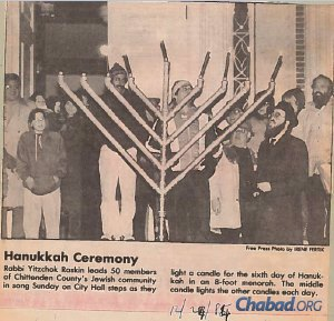 Following District Court Judge Billing's last-minute ruling in Dec. 1988, the menorah was allowed to go up in City Hall Park, which was captured in the Burlington Free Press.