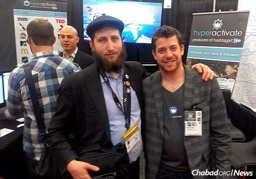 Lightstone with a startup entrepreneur from Tel Aviv on the SXSW showroom floor in a prior year.