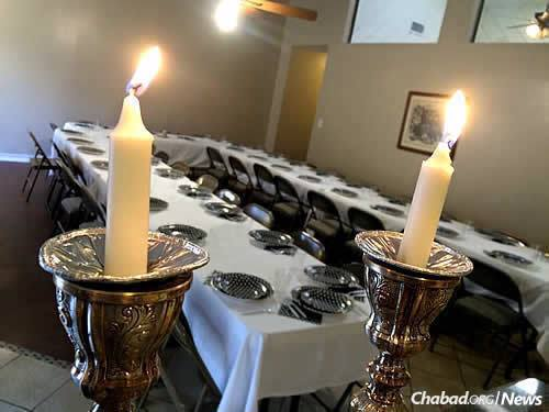 Tables are set for Shabbat dinner, which draws about 30 people each week.