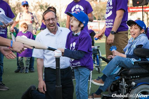 Jerusalem's Kraft Stadium was filled with smiles and laughter as players stepped up to the plate and then rounded the bases in an inaugural game for children with special needs, sponsored by the Friendship Circle of Central Jerusalem.
