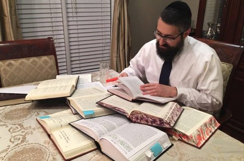 Rabbi Mendel Kaplan preparing for his class.