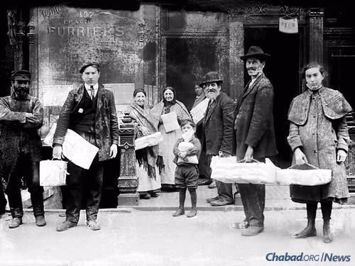For millenia in Jewish communities all over the world, special monies are raised for the express purpose of helping impoverished families with Passover expenses. Here, Jewish men, women and children in New York City take home packages of free matzahs.