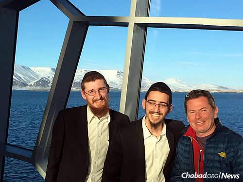 Rabbi Naftoli Pewzner, left, and Rabbi Dovber Paltiel enjoy the company of those in Iceland and the pristine waterways for which the country is famous.