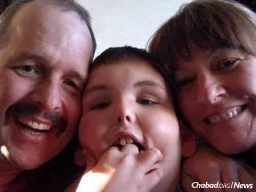 Raffle winner Trenton with his parents, Ryan and Linette Whiteman