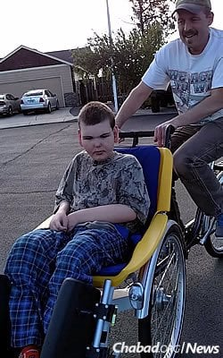 Trenton Whiteman, 17, of Oregon just got his bike; his father took him for a first spin.