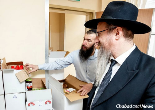 Chief Rabbi of Russia Berel Lazar, right, oversees the Matan BeSeiser Fund of Moscow.