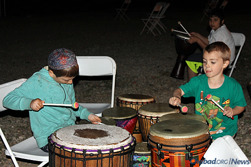 Kids enjoy the sounds of percussion; a drumming circle is again on tap for Lag BaOmer.