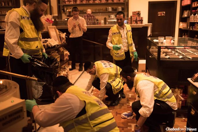 Volunteers from Zaka emergency services at the scene of a terrorist shooting in Tel Aviv that left four Israelis dead and 16 wounded.