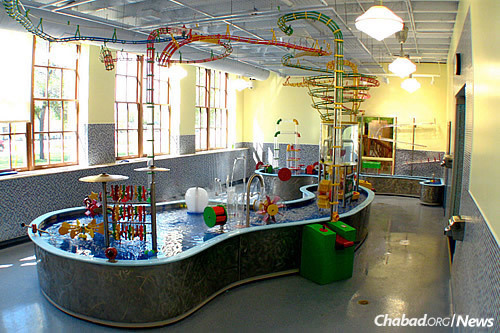 A giant water table will serve as a soothing place where individuals with special needs can work on therapeutic play and skills.