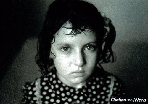 A little girl rescued by Children of Chernobyl.
