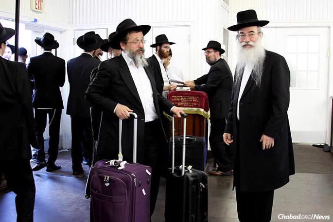 Rabbinic leaders, Talmudic scholars and Torah educators arrive in New York City for a scholarly conference known as Yarchei Kallah. Before they headed Upstate, many of them visited the Ohel—the resting place of the Lubavitcher Rebbe. (Photo: Meni Ben Shahar)