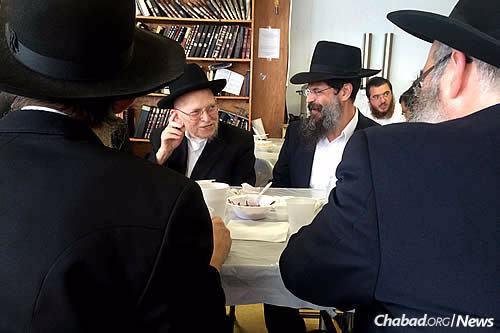 Rabbi Friedman catches up with former student Rabbi Avrohom Lapidus, rosh yeshivah (head of academy) of the historic Torat Emet yeshivah in 2016. (Photo: Meni Ben Shahar)