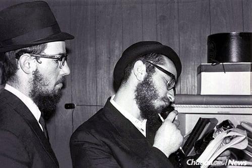 Wolff, right, and Chaim Baruch Halberstam working on the January broadcast. (Photo: Mulik Rivkin Archive)