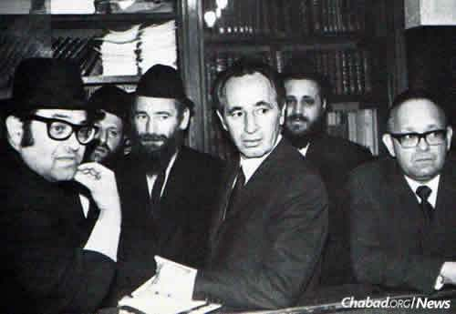 Peres at Lubavitch World Headquarters, waiting for his audience with the Rebbe.