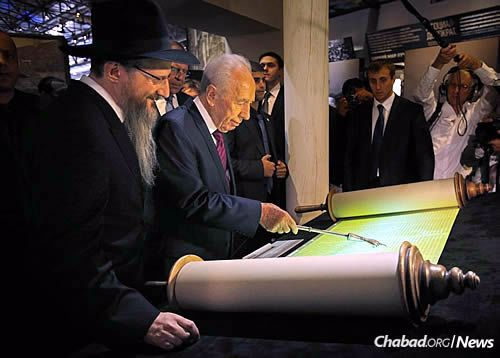 Inspecting a historic Torah scroll with Chief Rabbi of Russia Berel Lazar.