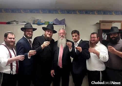 JLC instructors toast a l'chaim to the new venture, from left: Rabbi Yanki Biggs, Rabbi Shloimie Litvin, Rabbi Shmully Litvin, Rabbi Avrohom Litvin, Rabbi Mendy Litvin, Rabbi Chaim Litvin and Rabbi Boruch Susman