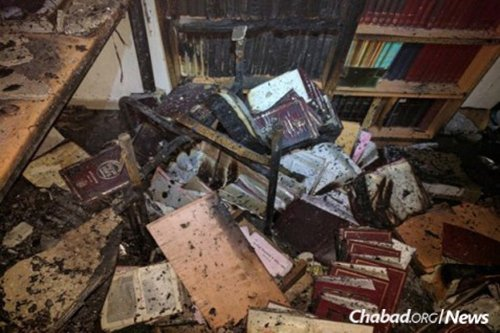 As flames approached yeshivah Mevaser Shalom in Haifa, students and teachers rushed to evacuate a nursery school on the first floor of their building. Having saved the children, the students attempted to return for the holy books, but the building was already engulfed in flames. (Photo: Yeshivah Mevaser Shalom)