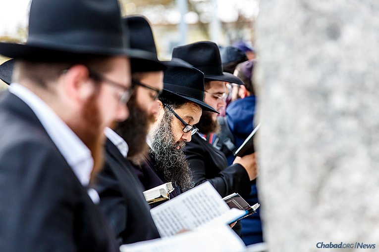 Praying at the resting place of the Lubavitcher Rebbe—Rabbi Menachem M. Schneerson, of righteous memory—and his father-in-law, the Sixth Rebbe—Rabbi Yosef Yitzchak Schneersohn, of righteous memory. (Photo: Eliyahu Parypa/Chabad.org)