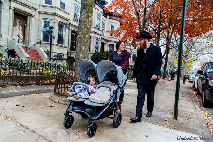 Rabbi Mendel and Mussie Alperowitz take a stroll with their children in the Crown Heights neighborhood of Brooklyn, N.Y. They will leave to become the Chabad-Lubavitch emissaries in South Dakota, the last of all 50 American states to get a permanent Chabad presence. (Photo: Eliyahu Parypa/Chabad.org)