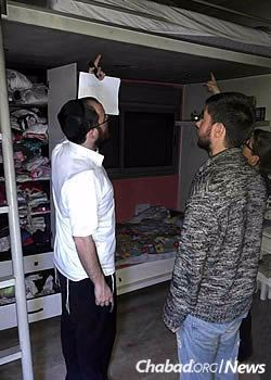 Assessing items in homes where fire struck. The cleanup work is just beginning. (Photo: Chabad on Campus International)