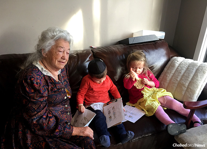 Christina Hacker, 92, visited the home of Rabbi Shmuel and Chasia Feldman in Canberra, Australia, after recently discovering her Jewish roots. Here, she enjoys the company of two of the Chabad couple's five children.