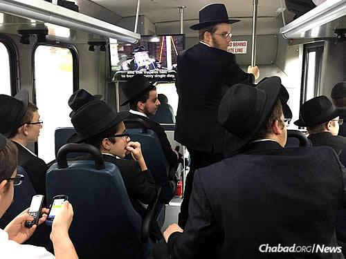The boys get to their destinations in three buses that take them directly to their routes. While onboard, they share ideas and watch inspirational videos of the Lubavitcher Rebbe.