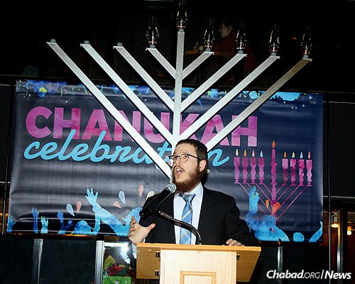 Rabbi Raphi Steiner of Chabad of Guelph in Ontario, Canada, speaking at last year's Chanukah celebration at the University of Guelph. He and his wife, Mussie, expect as many as 100 people to attend a Dec. 27 event at City Hall.