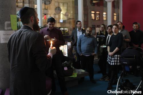 Rabbi Mordechai Lightstone, left, leads a Chanukah candle-lighting ceremony at the Tech Tribe event. (Photo: Tzvi Filler)