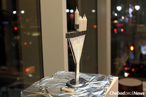 """The GIF menorah uses a technique known as """"digital mapping"""" to project short looping videos onto its front. (Photo: Tzvi Filler)"""
