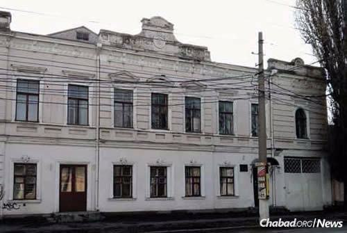 """Contemporary view of the old pharmacy on Bolshaya Morskaya Street in Nikolayev, where Rebbetzin Chana hid with her children and neighbors during a 1905 pogrom. """"It was remarkable to see how he walked around quieting the children,"""" wrote Rebbetzin Chana of her son, the Rebbe, who was 3 at the time. """"It was too dangerous to talk, lest the voices be heard outside; he gestured with his little hands to keep quiet, calming each child in a different manner."""" (Photo: Jewish Educational Media/Early Years)"""