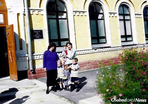 Esther Wilhelm, left, with some of her children and a woman outside of Zhitomir's historic synagogue. It was one of the sites of Chabad's underground Yeshivas Tomchei Temimim in the 1930s until it was shut down by authorities during an early-morning raid. The synagogue is in the midst of a multimillion-dollar expansion and renovation.